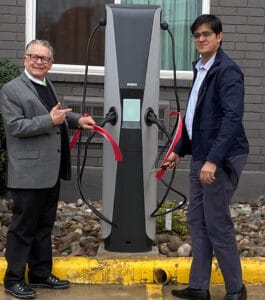 Amit Desai, Owner, Orangewood Inn Austin, is with Richard Osuch, CEO, My EV Charger. opening EV charging facility.